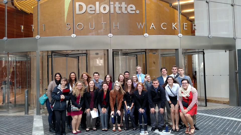Photo Credit: Students in the business learning community pose outside the Chicago office of Deloitte during the 2015 Big Trip.